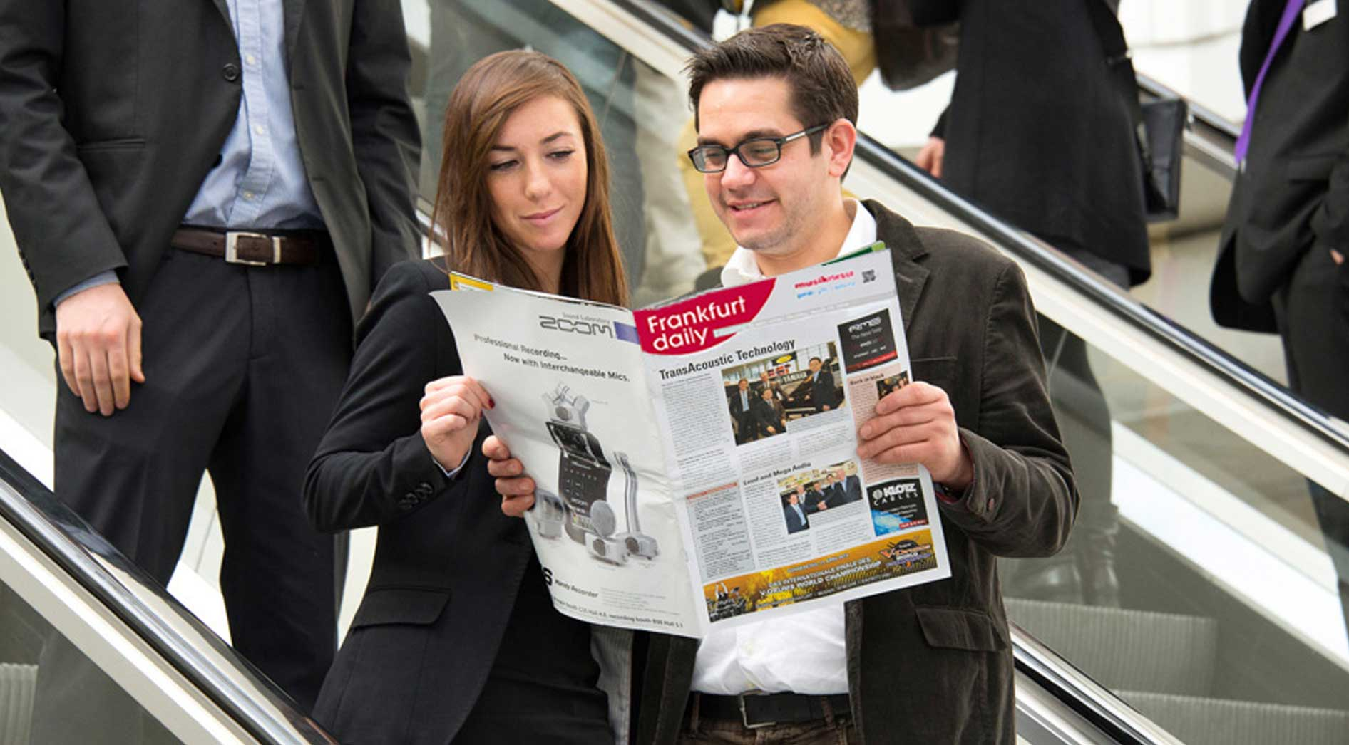 Visitors read the Frankfurt daily
