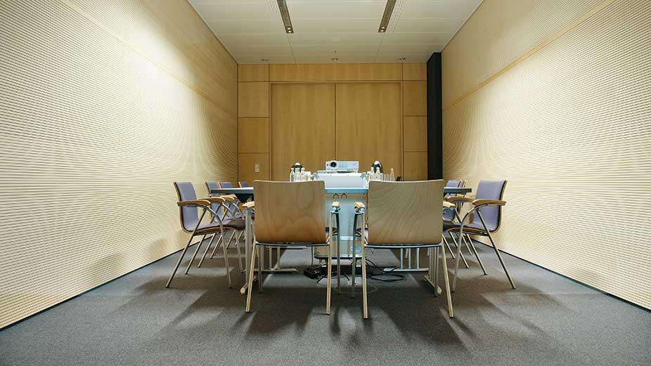 Conference room/meeting room with a table and chairs