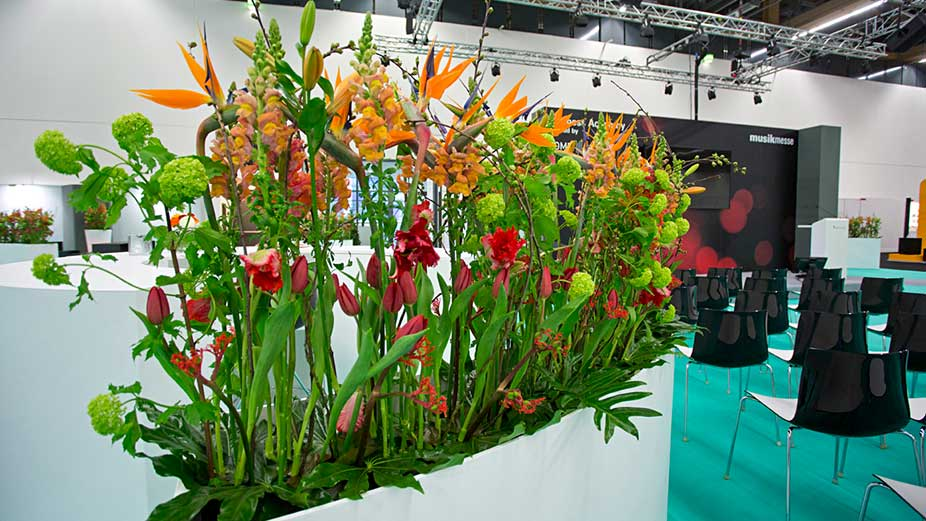 Plants and flowers decorate a booth