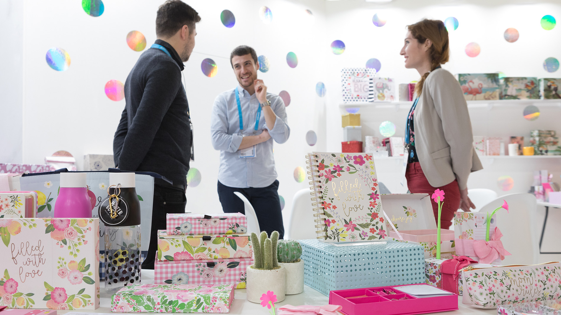 Business talk at a booth for gift items and packaging at Paperworld