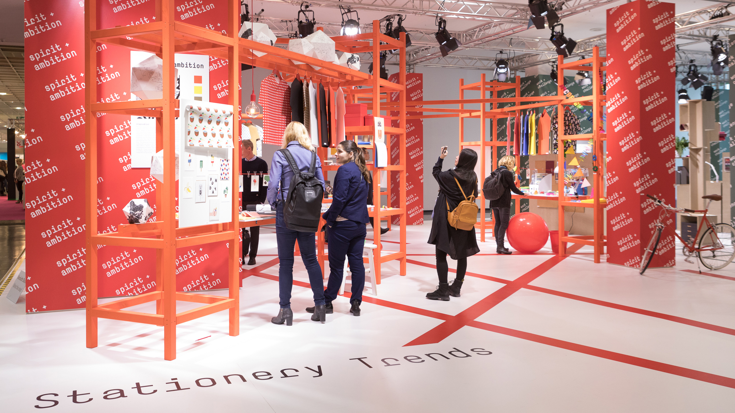 Visitors look at product trends in the stationery area at the Paperworld Trend Show