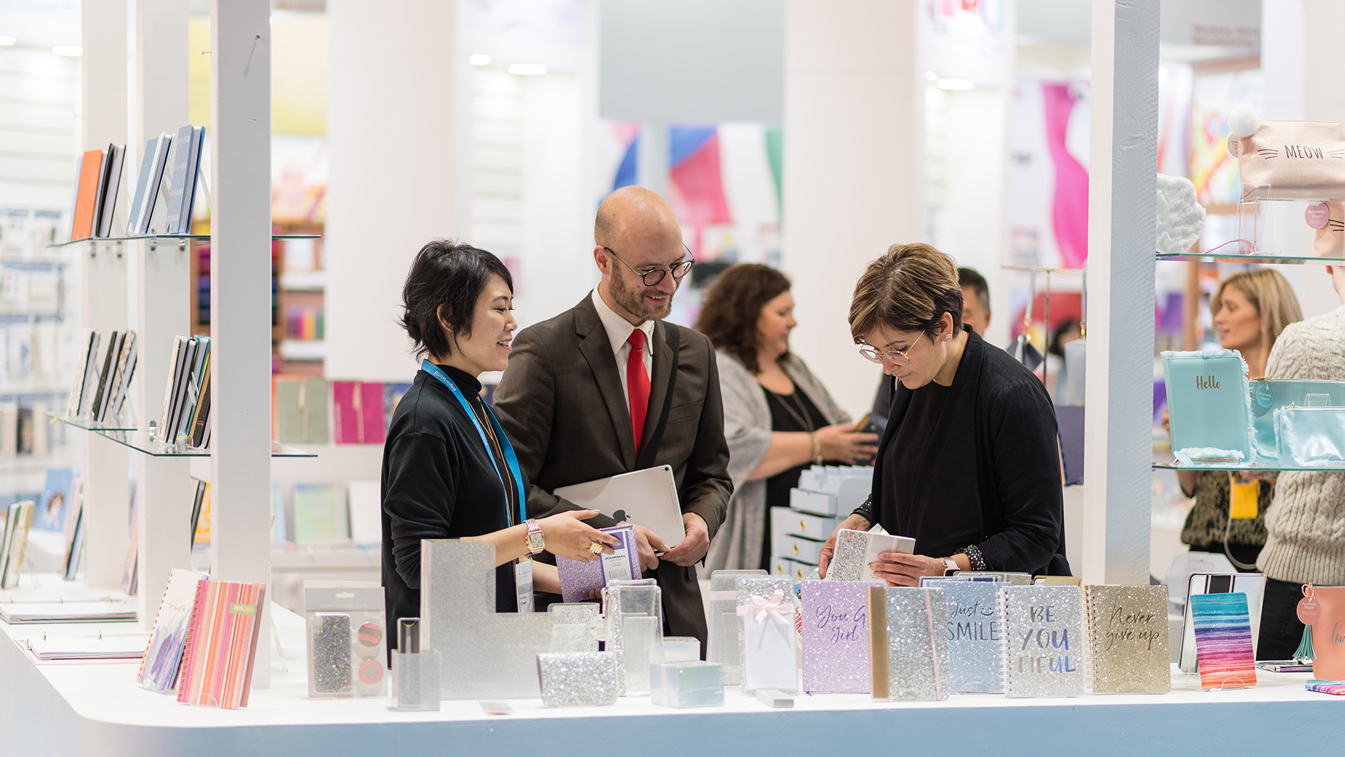 Sales pitch at a booth with notepads at Paperworld